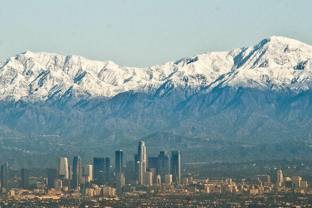 A view of snowcap mountains north of Downtown Los Angeles caused by a previous storm.