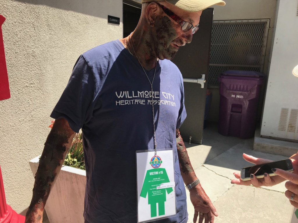 Ernie Villa with his completed moulage fake third degree burns. Each volunteer has a victim card that  lists their character's physical problem, respiration and mental state.