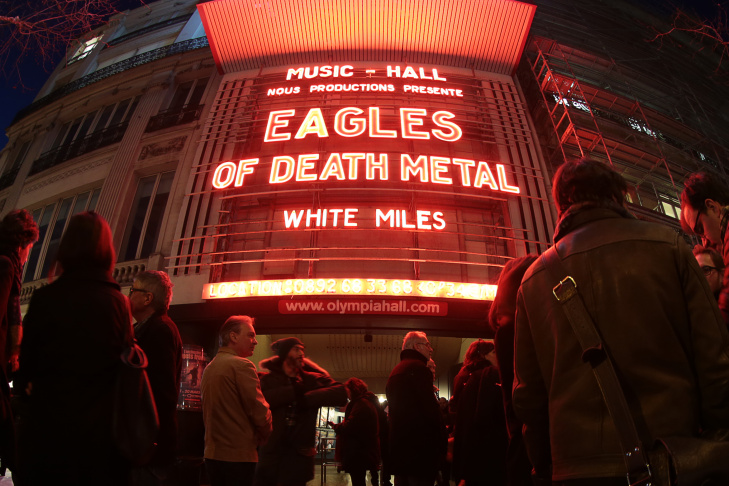 A picture taken with a fisheye lens shows people standing outside the Olympia concert venue in Paris, a few hours ahead of a concert by Southern California rock group Eagles of Death Metal, on Feb. 16, 2016. The rock group who were playing at the Bataclan music hall in Paris when jihadist gunmen burst in and killed 90 people in November returned to the French capital for a concert at the Olympia.
