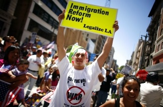 Demonstrators march during a May Day protest May 1, 2011, in downtown Los Angeles. Thousands of people marched for immigration reform, among other issues.