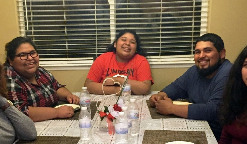 Amy Huerta (left), sister Katty and brother Luis Medellin and friends in Lindsay, Calif. Amy is the only member of her immediate family who can vote, but doesn't. Her brother Luis is trying to change that.