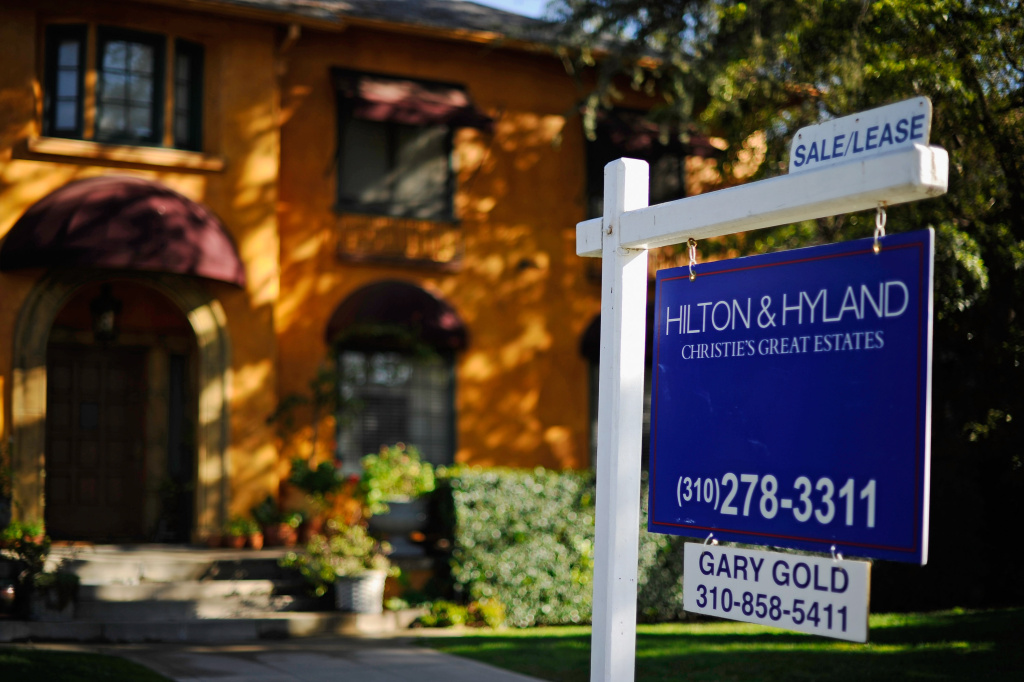 A for sale sign is seen in front of a home in  Los Angeles. U.S. home prices rose in most major cities in October compared with a year ago, pushed up by rising sales and a decline in the supply of available homes. (Photo by Kevork Djansezian/Getty Images)