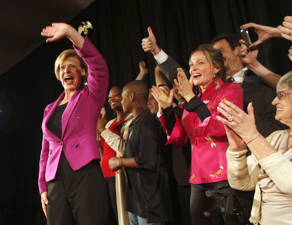 U.S. Senate candidate U.S. Rep. Tammy Baldwin (D-WI) celebrates her victory over Republican candidate Tommy Thompson as she enters the stage on election night on November 6, 2012 in Madison, Wisconsin. Baldwin became Wisconsin's first openly gay Senator.