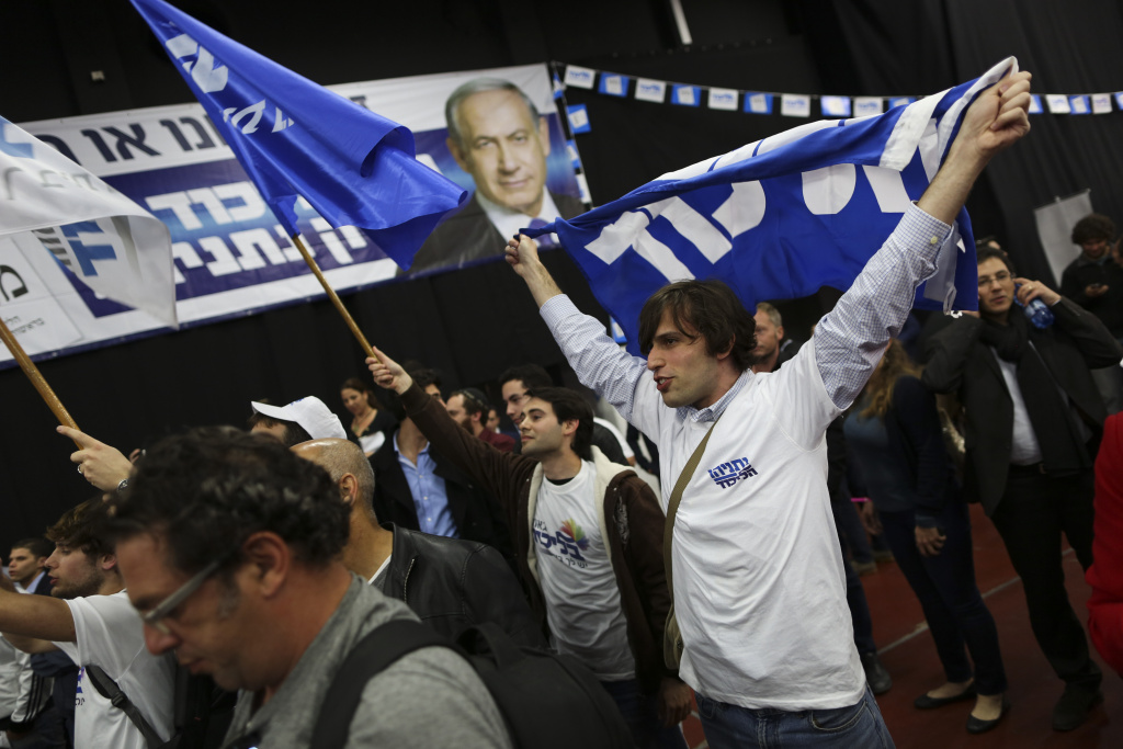 Israeli Prime Minister Benjamin Netanyahu Likud party supporters react to exit poll results at the party's election headquarters In Tel Aviv.Tuesday, March 17, 2015. Though exit polls showed a tight race, the results indicated that Netanyahu will have an easier time cobbling together a majority coalition, and the prime minister quickly tweeted out a statement declaring victory.