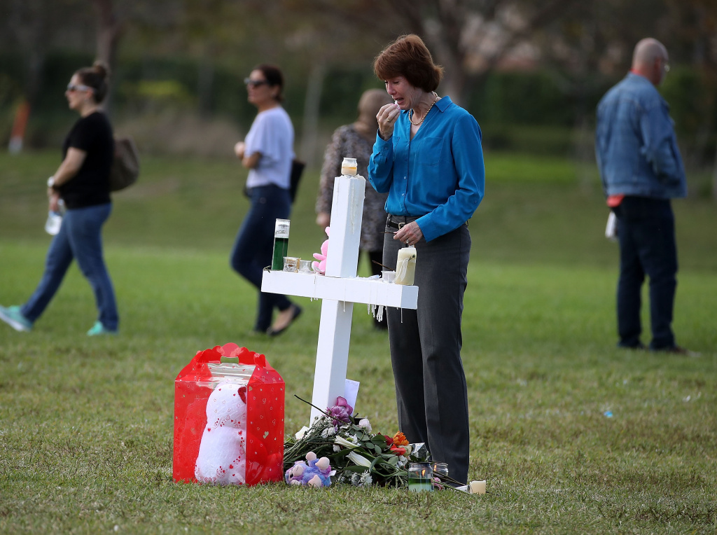 Florida gubernatorial candidate Gwen Graham visits a temporary memorial at Pine Trails Park on February 17, 2018 in Parkland, Florida.