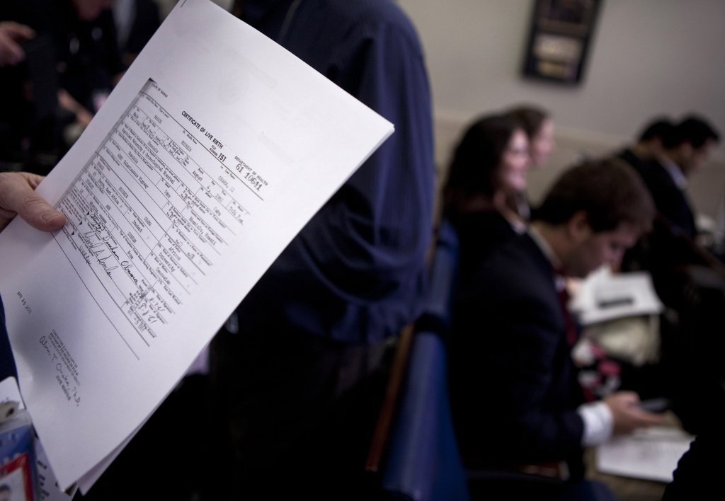A reporter holds a copy of President Barack Obama's long form birth certificate in the Briefing Room of the White House April 27, 2011 in Washington, DC.