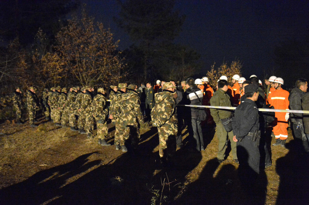 Chinese rescuers guard a closed area after an explosion in the Laoshan village of Kaili, in southwest China's Guizhou province, on January 13, 2014. An explosion has led to at least 14 deaths and seven injuries, according to a report by the China News Service.