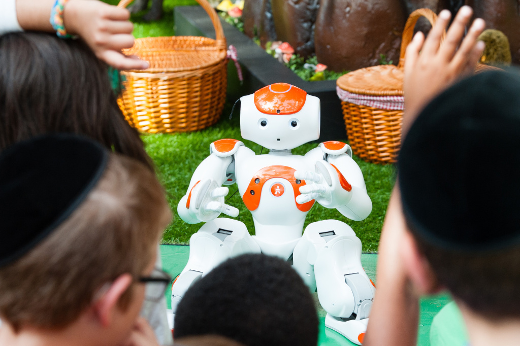 Alexander the friendly robot visits the Indoor Park to interact with children by telling classic fairy tales, singing and dancing at Westfield London on August 10, 2016 in London, England.