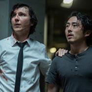 "Paul Dano, left, and Steven Yeun in ""Okja."""