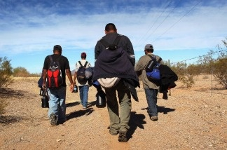 Mexican immigrants walk through the desert after illegally crossing the U.S.-Mexico border. A new pilot program by the Department of Homeland Security places ankle bracelets on some immigrants with the thinking that they will report back to immigration authorities.