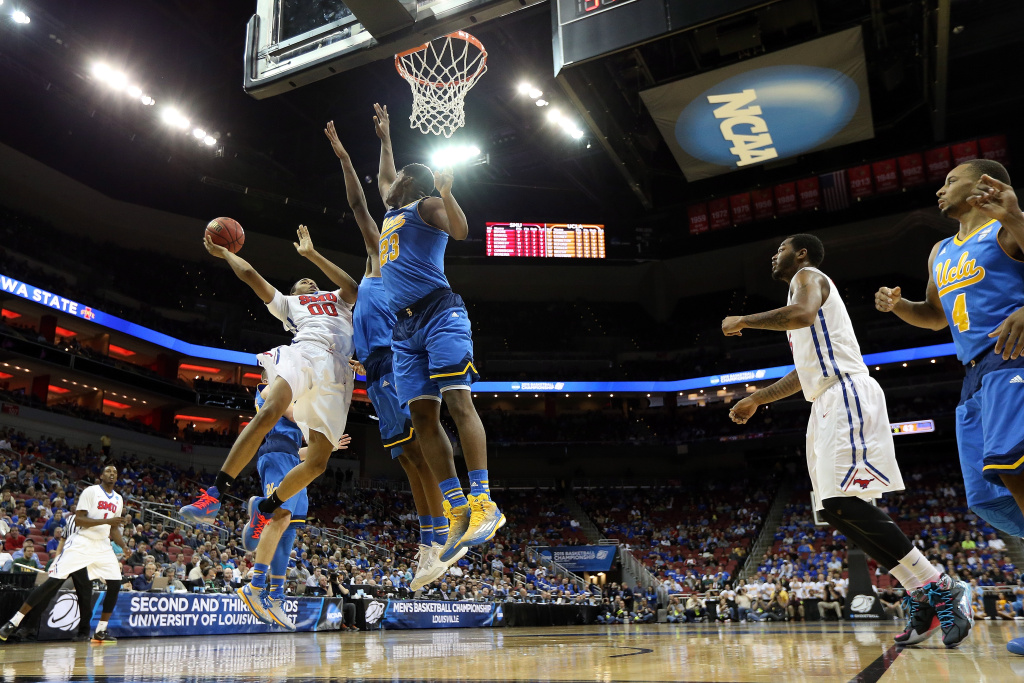 Ben Moore #0 of the Southern Methodist Mustangs drives against Tony Parker #23 of the UCLA Bruins during the second round of the 2015 NCAA Men's Basketball Tournamenat at the KFC YUM! Center on March 19, 2015 in Louisville, Kentucky.