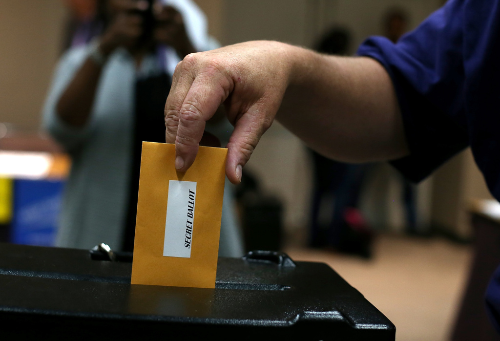 A Bay Area Rapid Transit (BART) worker with SEIU Local 1021 casts his ballot in a strike authorization vote on June 25, 2013 in Oakland, California.