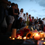 People gather and lay tributes on the Promenade des Anglais on July 15, 2016 in Nice, France. A French-Tunisian attacker killed 84 people as he drove a lorry through crowds, gathered to watch a firework display during Bastille Day Celebrations. The attacker then opened fire on people in the crowd before being shot dead by police.