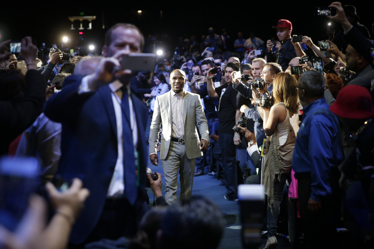 Boxer Manny Pacquiao, center, of the Philippines, arrives for a news conference, Wednesday, in Los Angeles. Pacquiao is scheduled to fight Floyd Mayweather Jr. in Las Vegas on May 2.