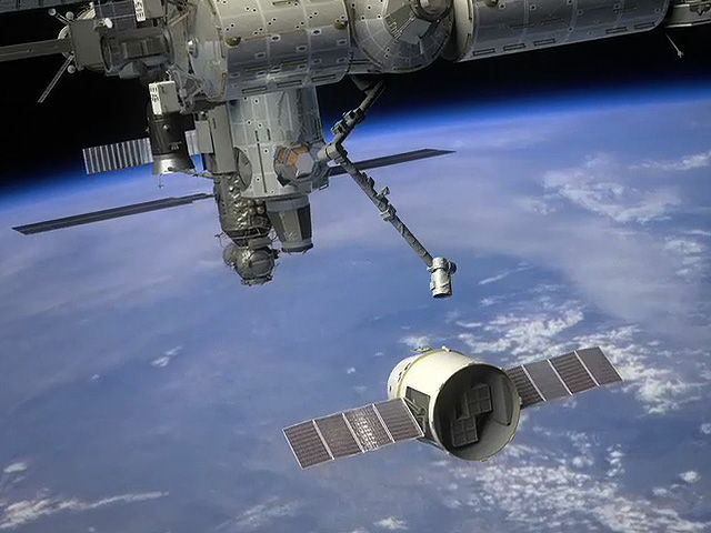 A NASA rendering of SpaceX's Dragon capsule as it prepares to berth with the International Space Station.