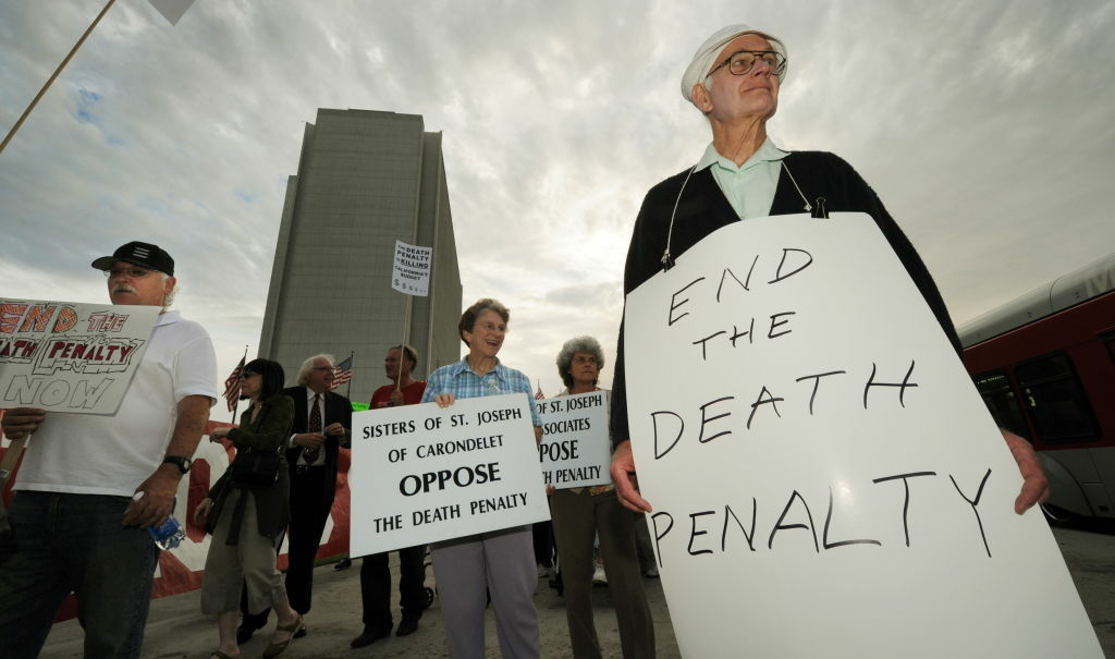 Anti-death penalty campaigners stage a demonstration and march outside the Federal Bulding in Los Angeles on September 28, 2010.