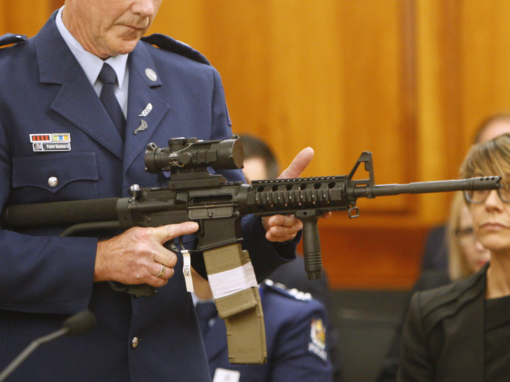 Police Sr. Sgt. Paddy Hannan holds an AR-15 style rifle similar to a weapon a gunman used to kill 51 people at two mosques in Christchurch, New Zealand. Dozens of gun owners handed over their weapons in the first of more than 250 planned buyback events around New Zealand.