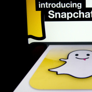 "The logo and a page of mobile app ""Snapchat"" are displayed on tablets. Hackers broke into Snapchat, the popular mobile app, accessing the phone numbers and usernames of 4.6 million users and publishing them online."