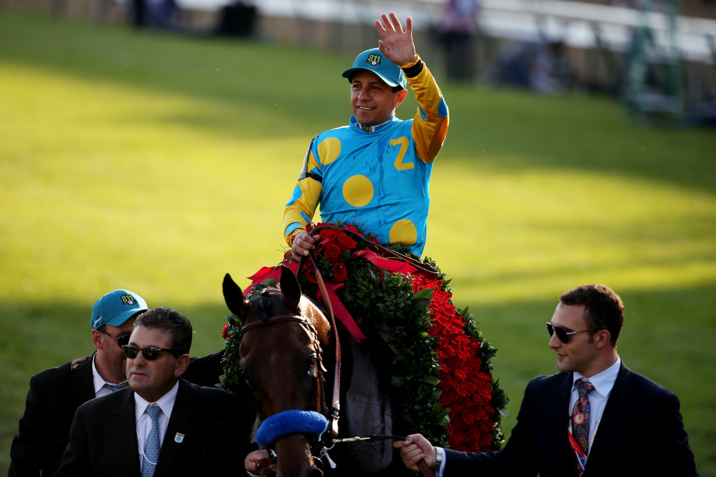 Jockey Victor Espinoza celebrates atop of American Pharaoh #18 on his way winners circle after winning the 141st running of the Kentucky Derby at Churchill Downs on May 2, 2015 in Louisville, Kentucky.
