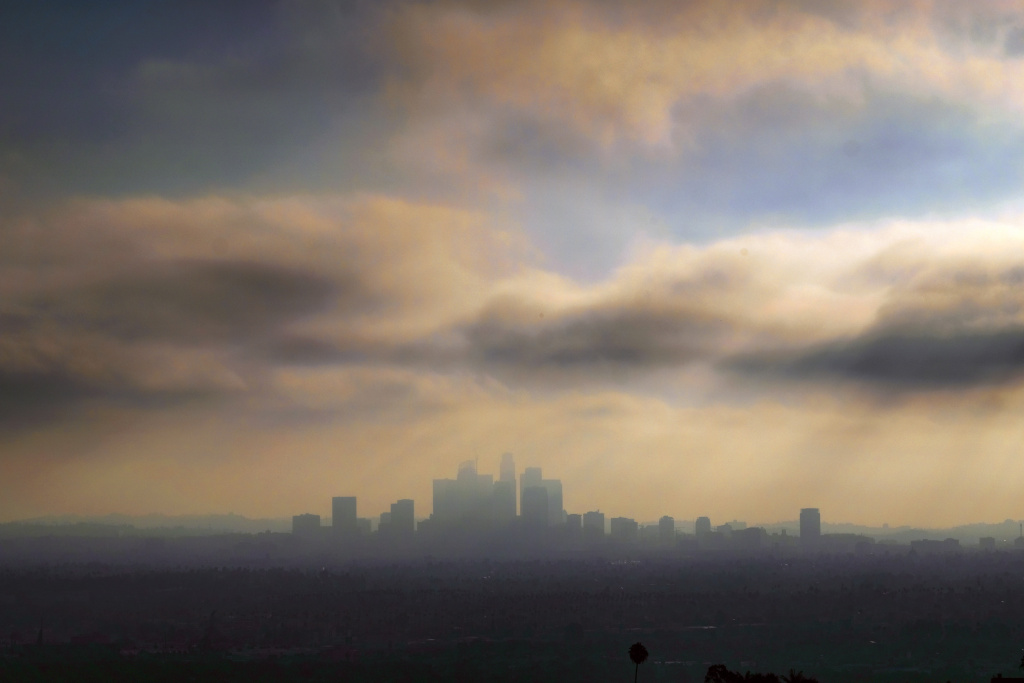Downtown Los Angeles is shrouded in early morning coastal fog on Friday, Aug. 12, 2016.  Southern California is having its smoggiest summer in nearly a decade and hospitals report an increase of people with breathing problems.   (AP Photo/Richard Vogel)