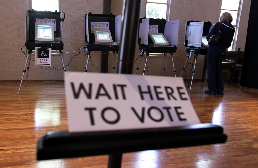 A local resident casts her vote at a polling station in St Andrew Presbyterian Church March 6, 2012 in Sandy Springs, Georgia.