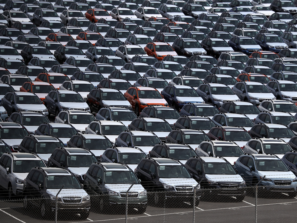 New cars sit in a lot at the Port of Richmond in California on May 24, 2018. The Trump administration on Friday announced a six-month delay in setting new tariffs on auto imports.