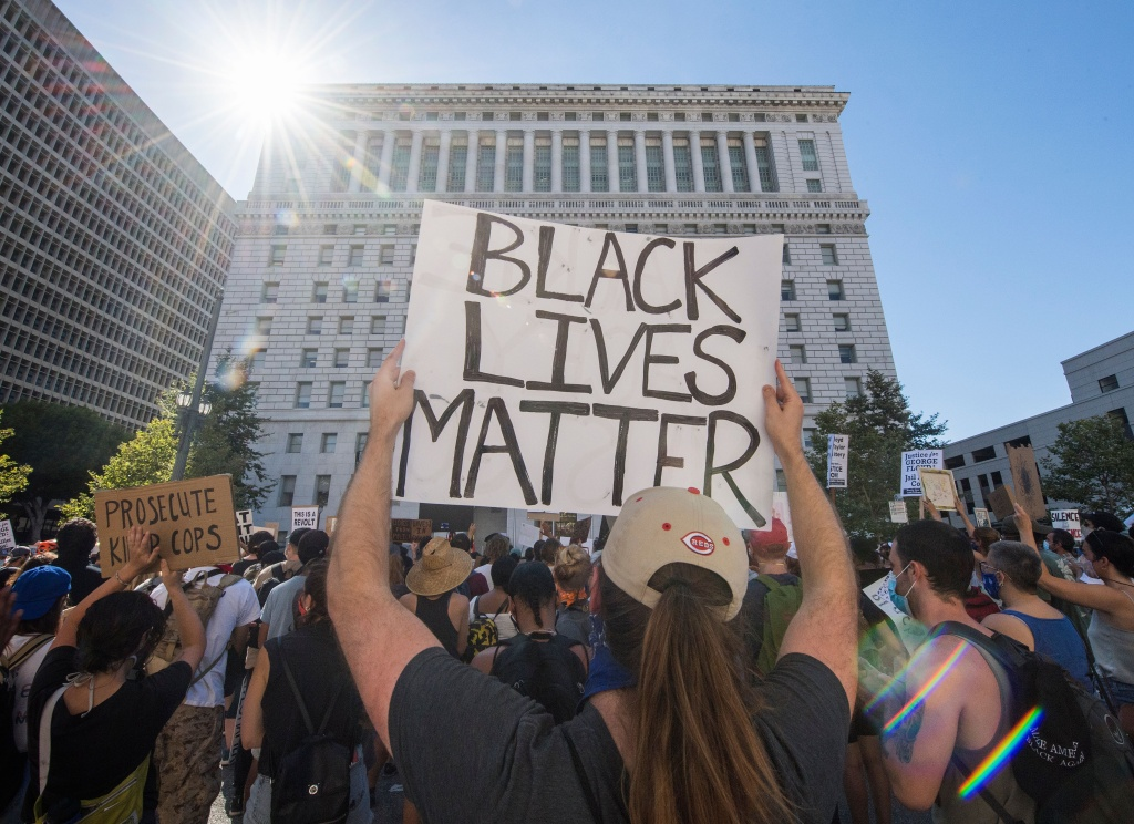 Supporters of Black Lives Matter, hold signs during a protest outside the Hall of Justice as they demonstrate against the death of George Floyd, in Los Angeles, California on June 10, 2020.