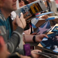 Fans hoping to get a signature from actor Daniel Radcliffe hold Harry Potter photos, at Radcliffe's star unveiling ceremony on the Hollywood Walk of Fame, November 12, 2015.