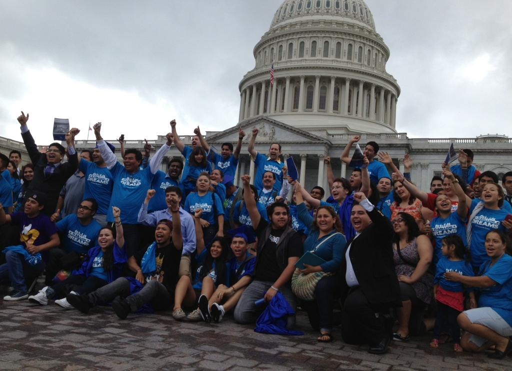 A group of young immigration reform supporters celebrates the passage of the Senate's immigration reform bill on Thursday in Washington, D.C. The Senate voted 68-32 on a bill that would tighten border security while allowing a path to legal status and eventual citizenship for immigrants living in the U.S. illegally.