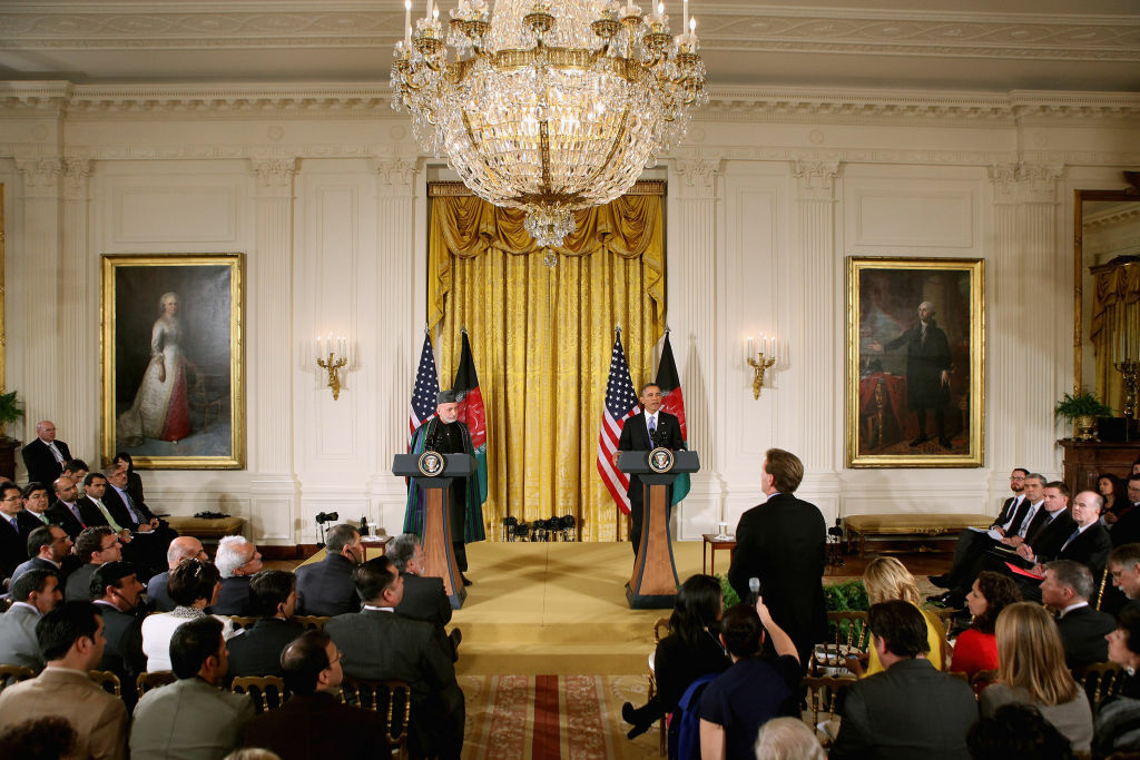 WASHINGTON, DC - JANUARY 11:  Afghan President Hamid Karzai (L) and U.S. President Barack Obama hold a joint news conference in the East Room of the White House January 11, 2013 in Washington, DC. Karzai is in Washington for face-to-face meetings with Obama and senior members of his administration about the future of American commitment to Afghanistan and when troops may leave the country after more than 10 years of war.  (Photo by Chip Somodevilla/Getty Images)