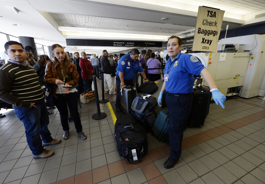 Transportation Security Administration workers screen luggage in Terminal 2 of Los Angeles International Airport.