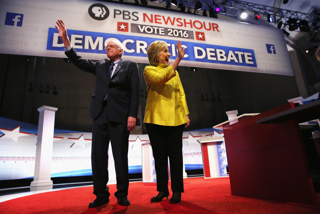 Democratic presidential candidate Senator Bernie Sanders (L) and Hillary Clinton participate in the PBS NewsHour Democratic presidential candidate debate at the University of Wisconsin-Milwaukee.