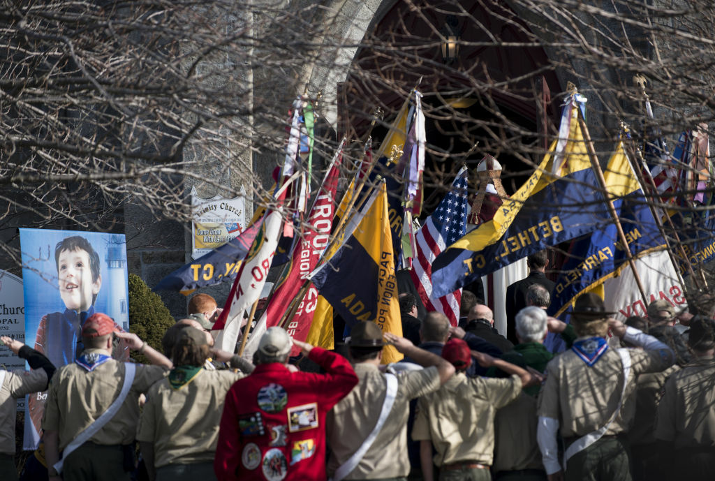 Area Boy Scouts salute the casket of a victim of the mass shooting at Sandy Hook Elementary School.