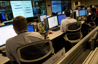 Analyists at the National Cybersecurity & Communications Integration Center prepare for Cyber Storm III during a media session at their headquarters in Arlington, VA, Sept. 24, 2010. Cyber Storm III is NCCIC's capstone national-level cybersecurity exercise.