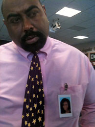 Mitrice Richardson's father Michael Richardson at a press conference on Aug. 12, 2010. He wears his daughter's photo on his chest.