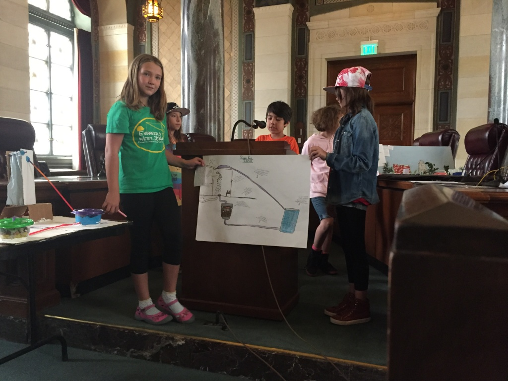 Another group of fourth graders from Los Feliz Charter School for the Arts presents their system to gather waste water from showers and filter it for reuse.
