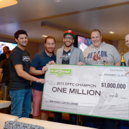 LAS VEGAS, NV - DECEMBER 15:  (L-R) Draftstreet co-founders Mark Nerenberg, Jeremy Elbaum and Michael Klbort, 2nd place winner Matt Sidla, 3rd place winner Matt Renkwick and Draftstreet co-founder Brian Schwartz pose with a $1,000,000 check during the $1,000,000 Draftstreet Fantasy Football Championship 2013 at Legasse's Stadium at The Palazzo Las Vegas on December 15, 2013 in Las Vegas, Nevada.