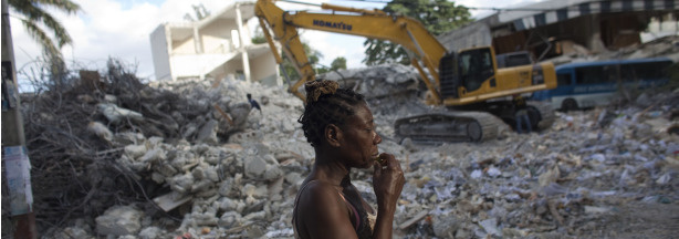 A woman walks past a destroyed house in Port-au-Prince, Haiti. Haiti is still trying to recover from a powerful 7.0-strong earthquake on Jan. 12, 2010.