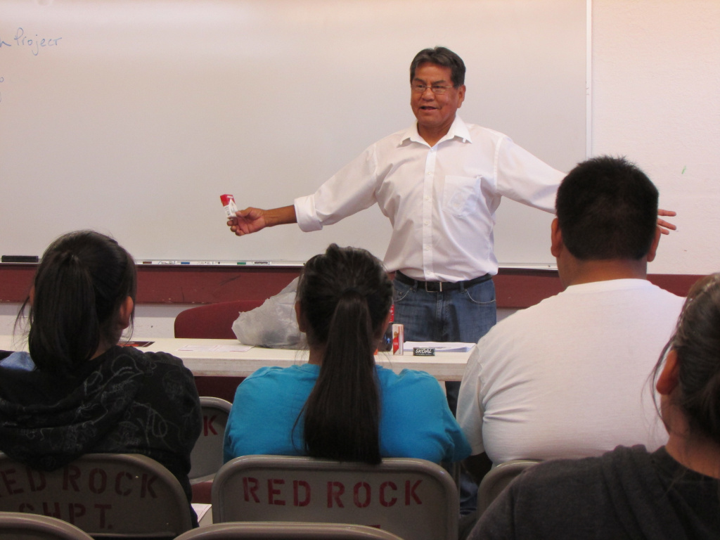 Rob Carr addresses a group of Navajo youths and elders at the Red Rock chapter house about the dangers of smoking and secondhand smoke.