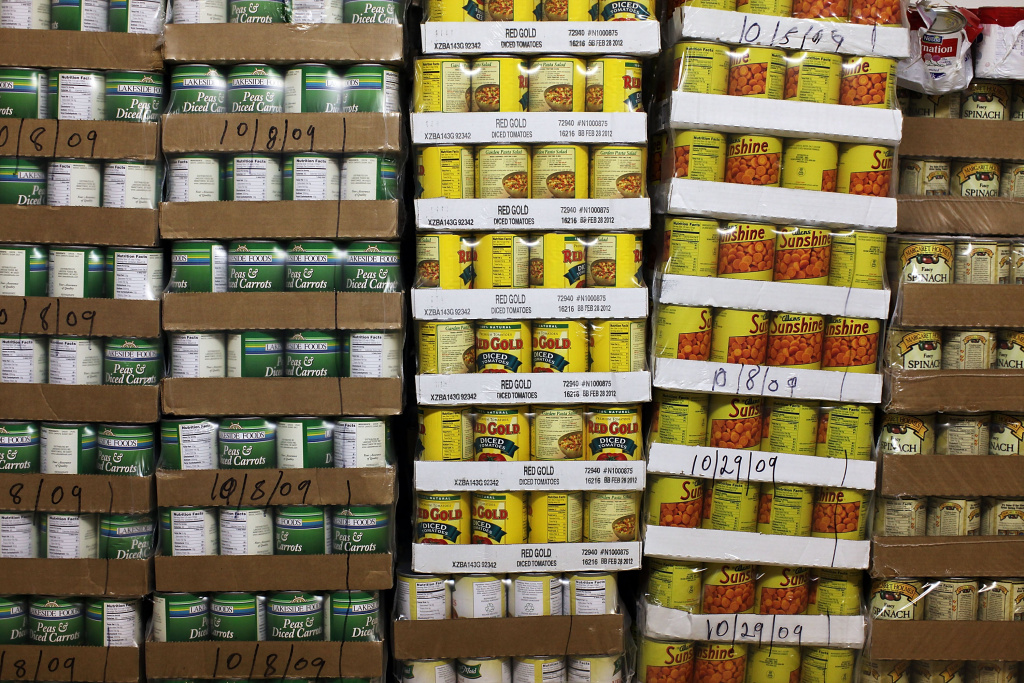 Pallets of canned goods are stacked inside the food pantry at St. Augustine's Church on November 23, 2009 in the Bronx borough of New York City.
