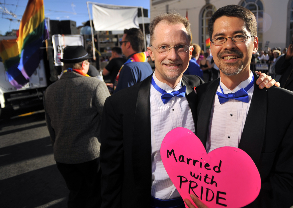 Stuart Gaffney (R) poses with his husband John Lewis (L) as celebrations ensue in the Castro neighborhood of San Francisco, California, June 26, 2012, after the US Supreme Court struck down The Defense of Marriage Act (DOMA), and declared that same-sex couples who are legally married deserve equal rights to the benefits under federal law that go to all other married couples. In another ruling, the Supreme Court cleared the way for same-sex marriages to resume in California as the justices, in a procedural ruling, turned away the defenders of Proposition 8.