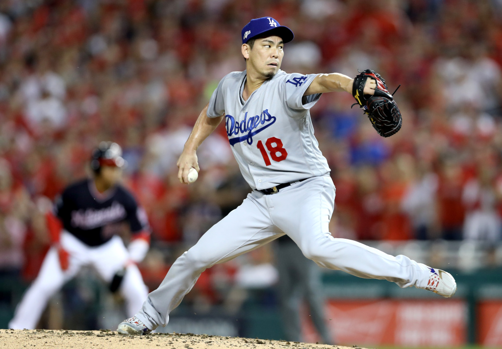 Kenta Maeda #18 of the Los Angeles Dodgers delivers in the third inning against the Washington Nationals in game four of the National League Division Series at Nationals Park on October 07, 2019.