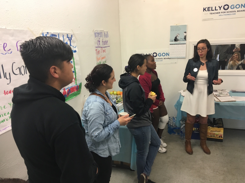 L.A. school board candidate Kelly Gonez, left, addresses campaign volunteers before a day of door-knocking on Sunday, March 5.