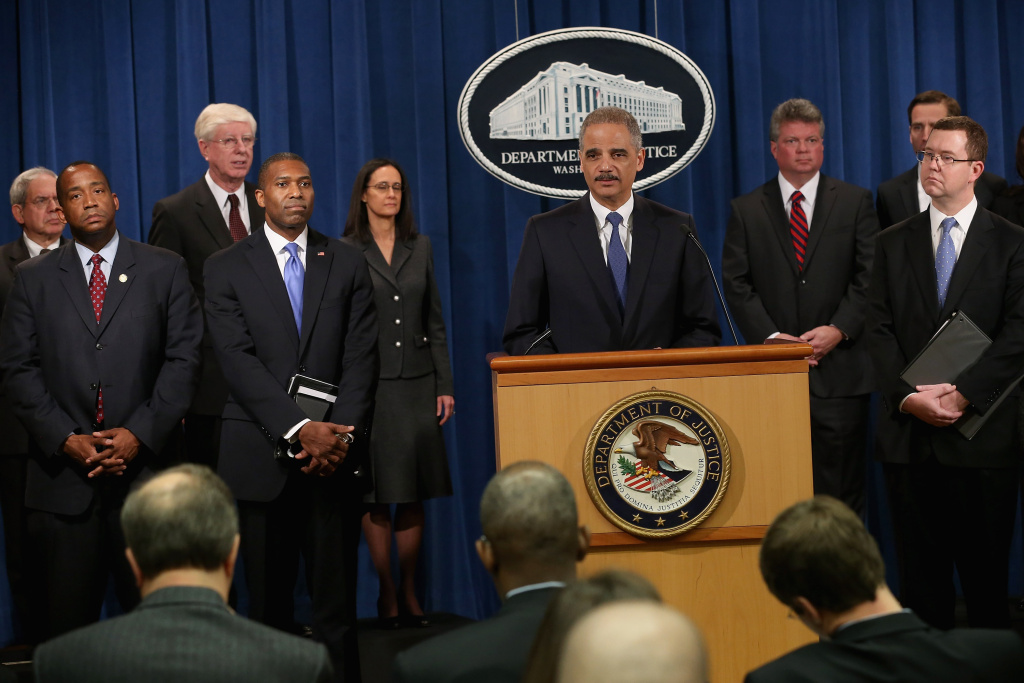 U.S. Attorney General Eric Holder leads a news conference with Acting Associate Attorney General Tony West, Principal Deputy Assistant Attorney General Stuart Delery and attorneys general from eight states and the District of Columbia at the Department of Justice February 5, 2013 in Washington, DC. Holder announced that the United States is bringing a civil lawsuit against the ratings agency Standards & Poor's and its parent company, McGraw-Hill Companies, over its pre-fiscal crisis bond ratings.