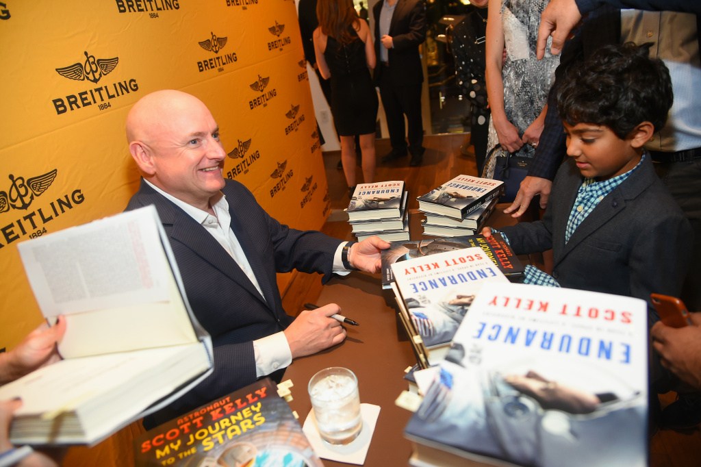 Retired Astronaut Scott Kelly signs his new book for guests at Breitling Boutique on October 14, 2017 in New York City.