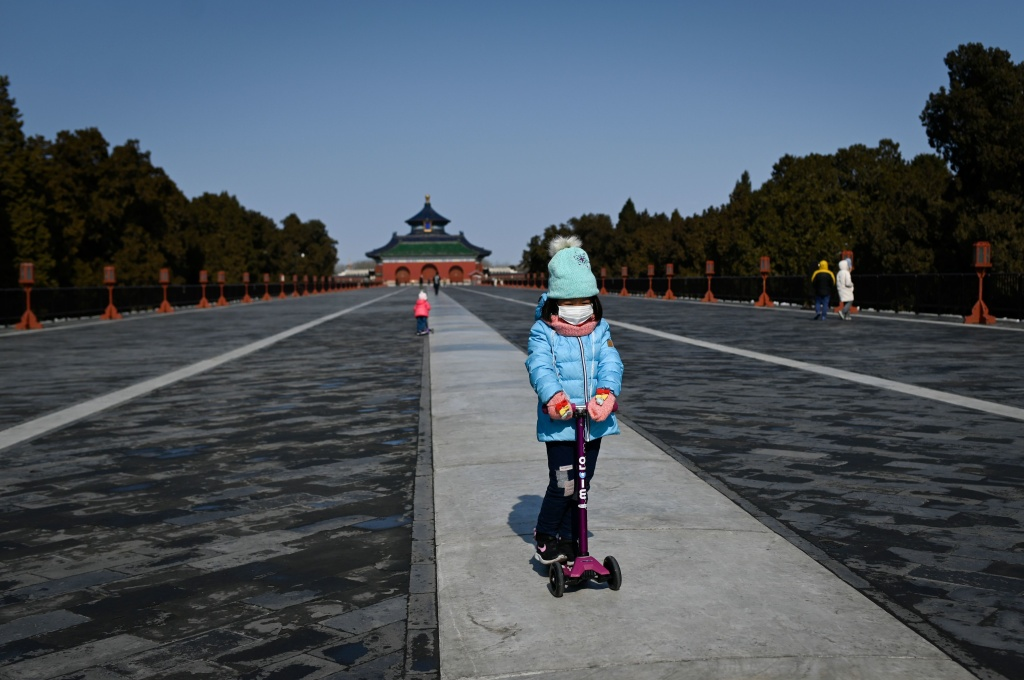 A girl in a park in Beijing on Feb, 15. Researchers are looking at the impact of the newly identified coronavirus on children.