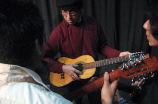 A student playing guitar