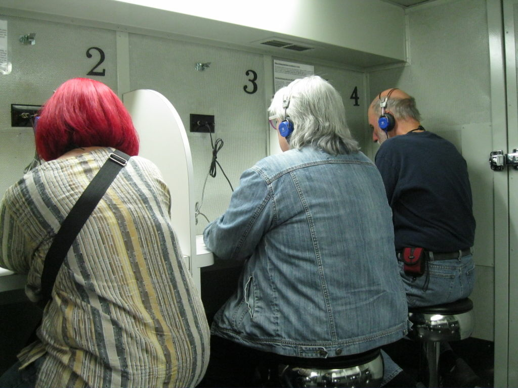 Musicians and music fans get their ears checked at the House Research Institute's hearing booth at the recent NAMM Show in Anaheim.