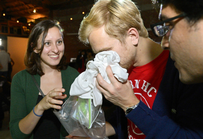 Konstantin Bakhurin, left, and Martina Desalvo smell shirts during a pheromone party, Friday, June 15, 2012, in Los Angeles. The get-togethers, which have been held in New York and Los Angeles and are planned for other cities, require guests to submit a slept-in T-shirt that will be sniffed by other participants. Then you can pick your partner based on scent. (AP Photo/Mark J. Terrill)