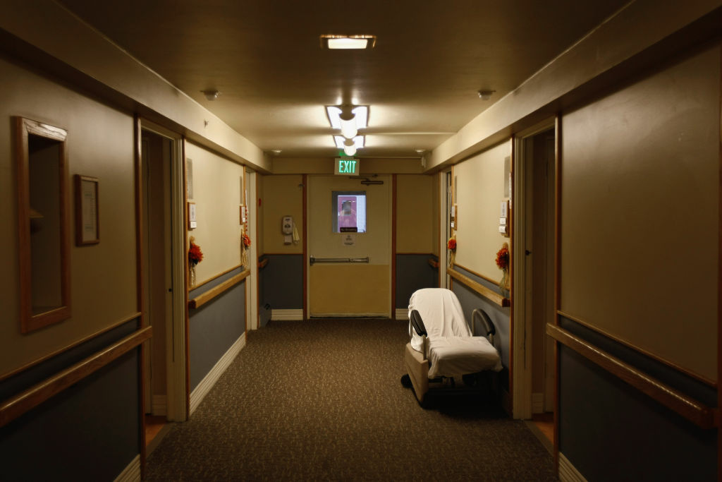 A mobile recliner sits outside the room of a terminally ill resident of the Hospice of Saint John on November 5, 2009 in Lakewood, Colorado.